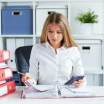 Woman doing paperwork for Year-End Payroll | CTR Payroll | Pittsburgh